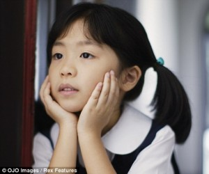 young chinese girl looking sad