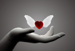 Heart floating above open hand