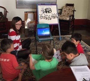 Children learning Chinese using a computer