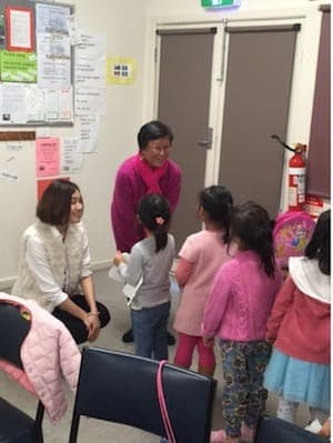 Dr Moni Storz with children learning Chinese Mandarin