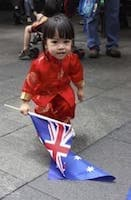 Little Chinese girl holding Australian flag
